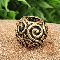 Bartperle mit keltischem Doppelspiralmuster aus Bronze